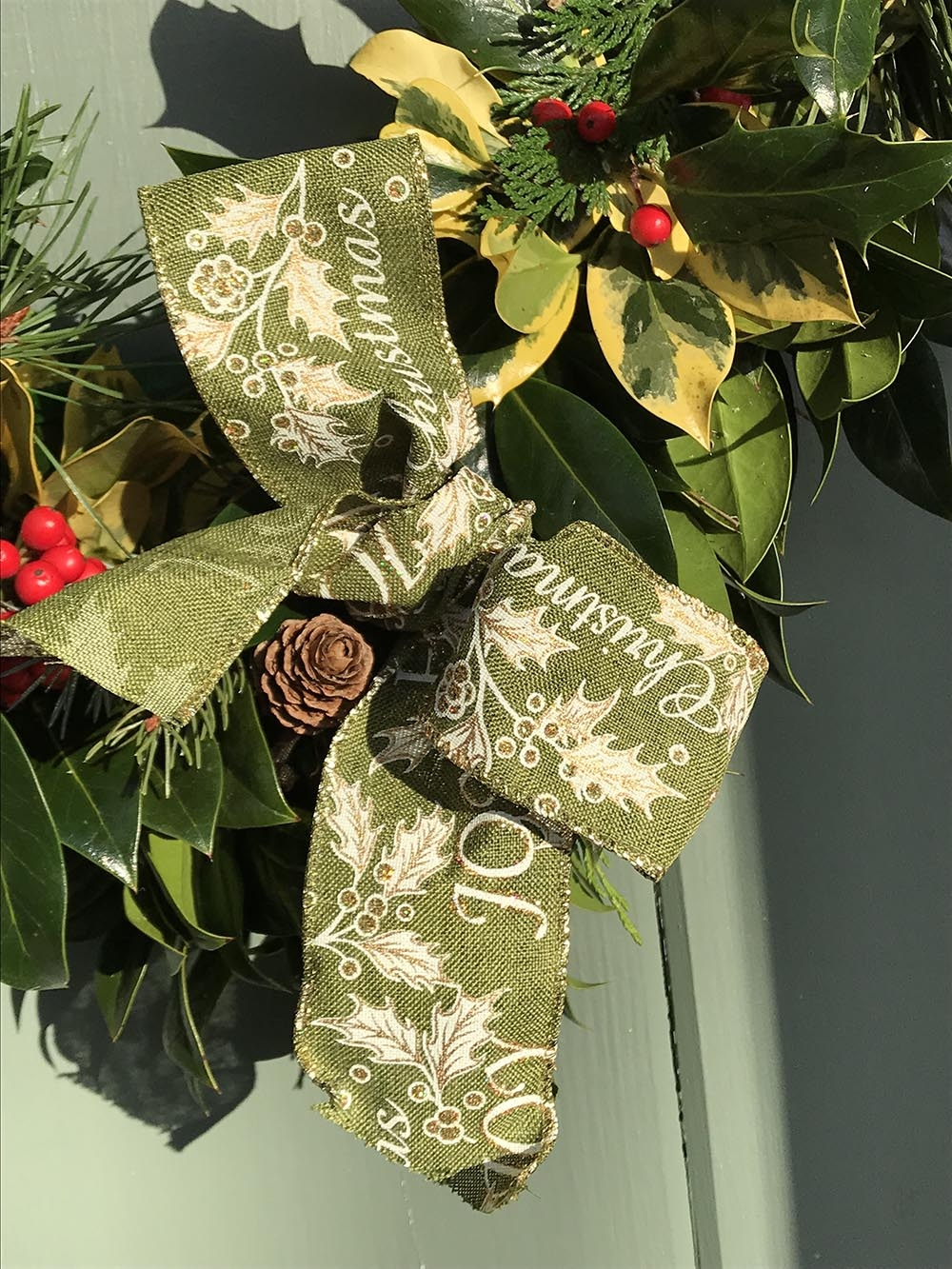 holly wreath with ribbon bow