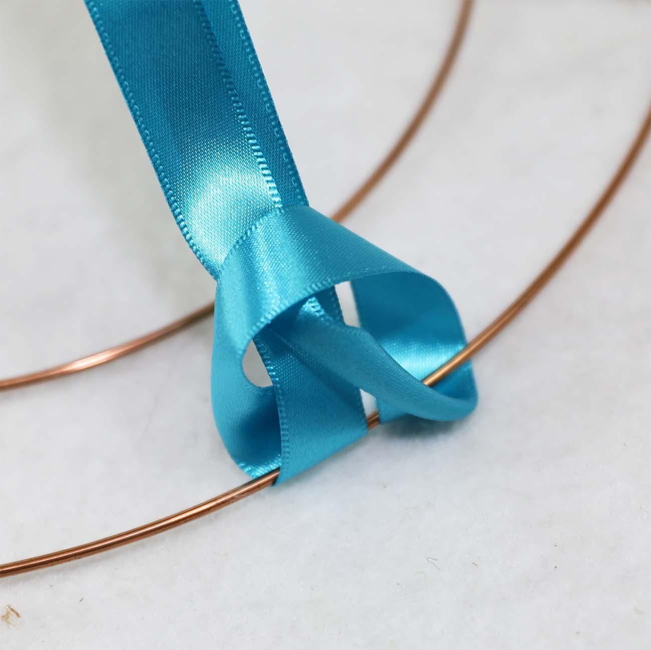 ribbon larks head knot stage three